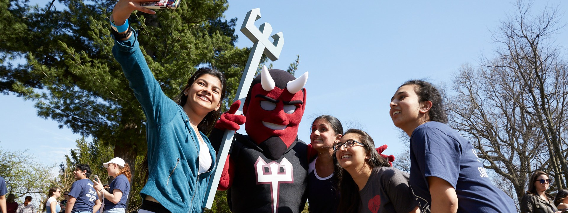 students with USciences Mascot, Drake the Devil