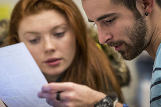 two students looking at paper
